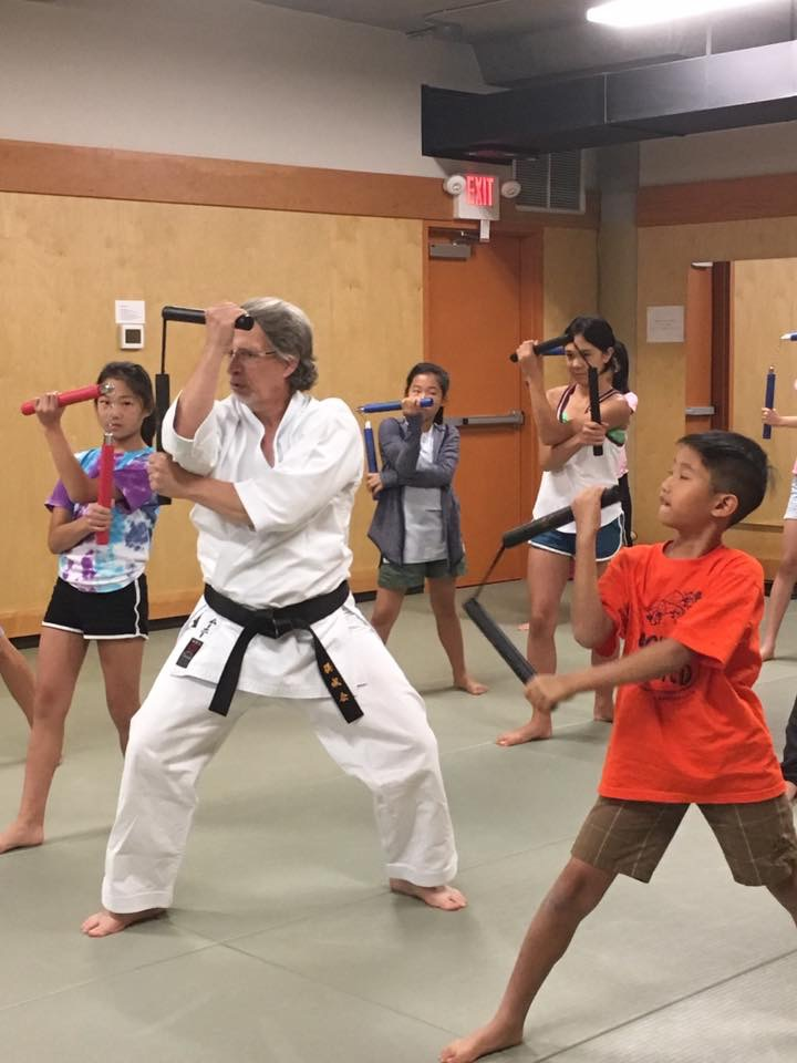 Bob and Naomi (The Mooney Family) give back through Karate and the positive impacts it provides people of all ages.