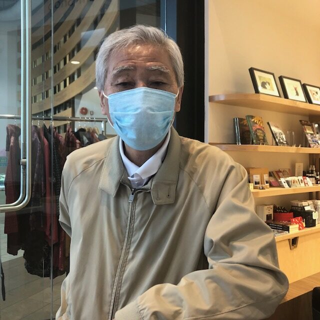 Masao K. enjoys the camaraderie of volunteering with others at the Nikkei Centre bookstore