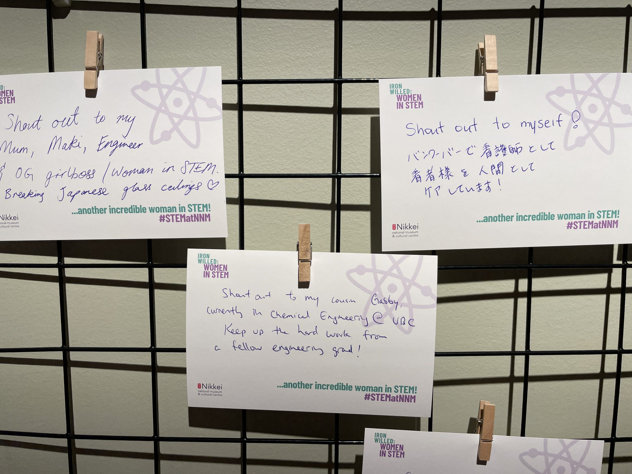 Photo of three postcards with supportive messages to women in STEM.